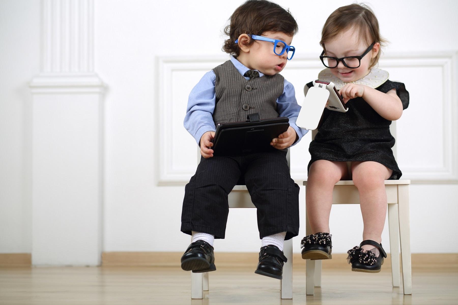 bigstock Two little kids in glasses sit 76626623