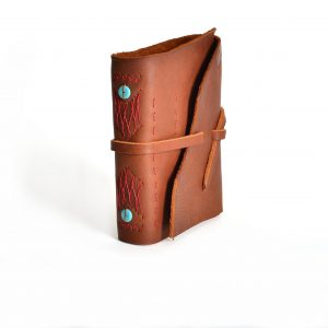 handmade black and brown leather journal with hand stitching and beads on spine with leather tie and acid free pages