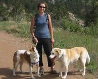 Dr. Karsten with two dogs on a trail