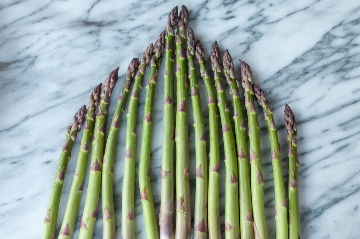 asparagus triangle pyramid on marble countertop
