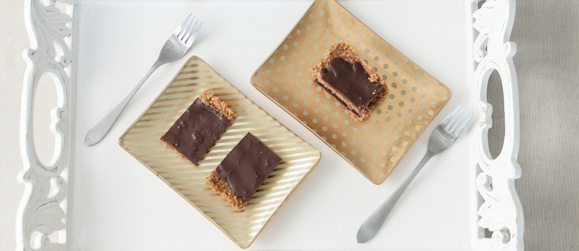 chocolate almond protein bars on white cottage chic serving tray