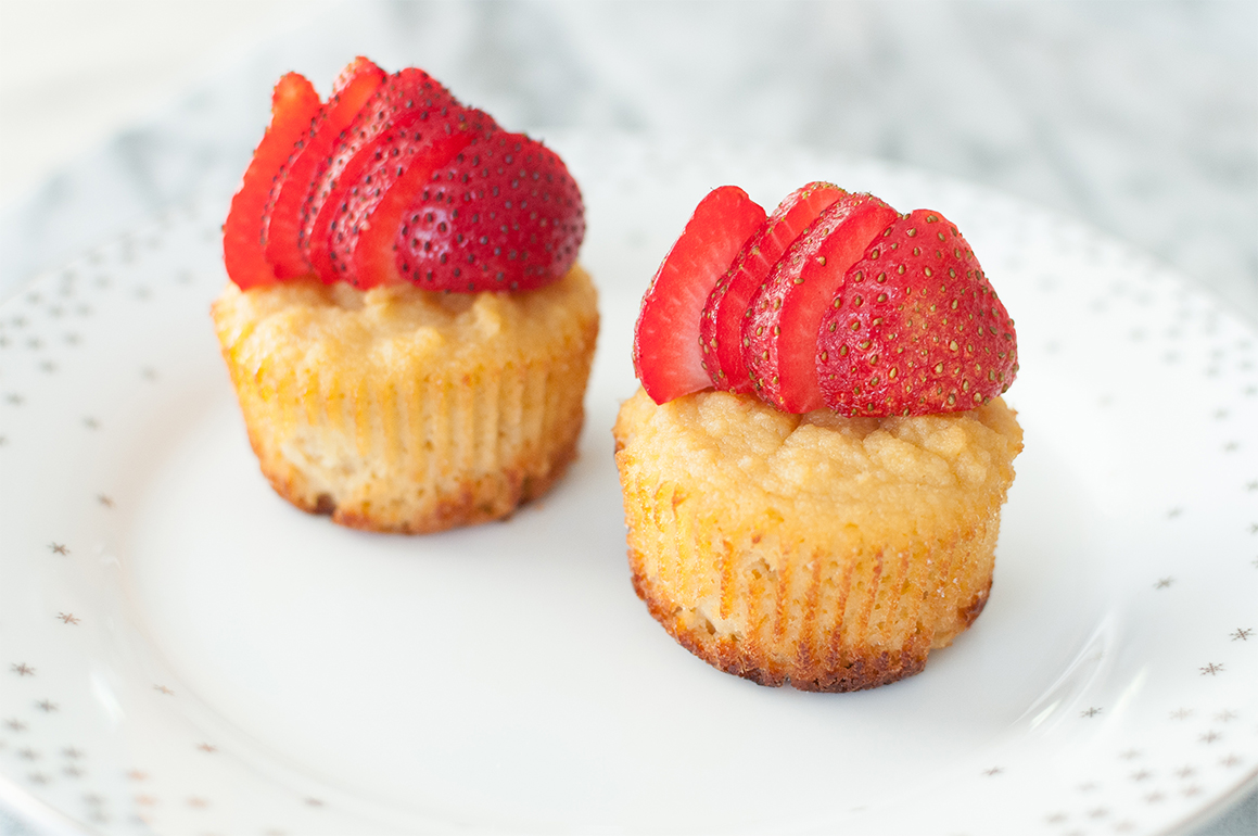 lemon cupcakes with strawberries on top