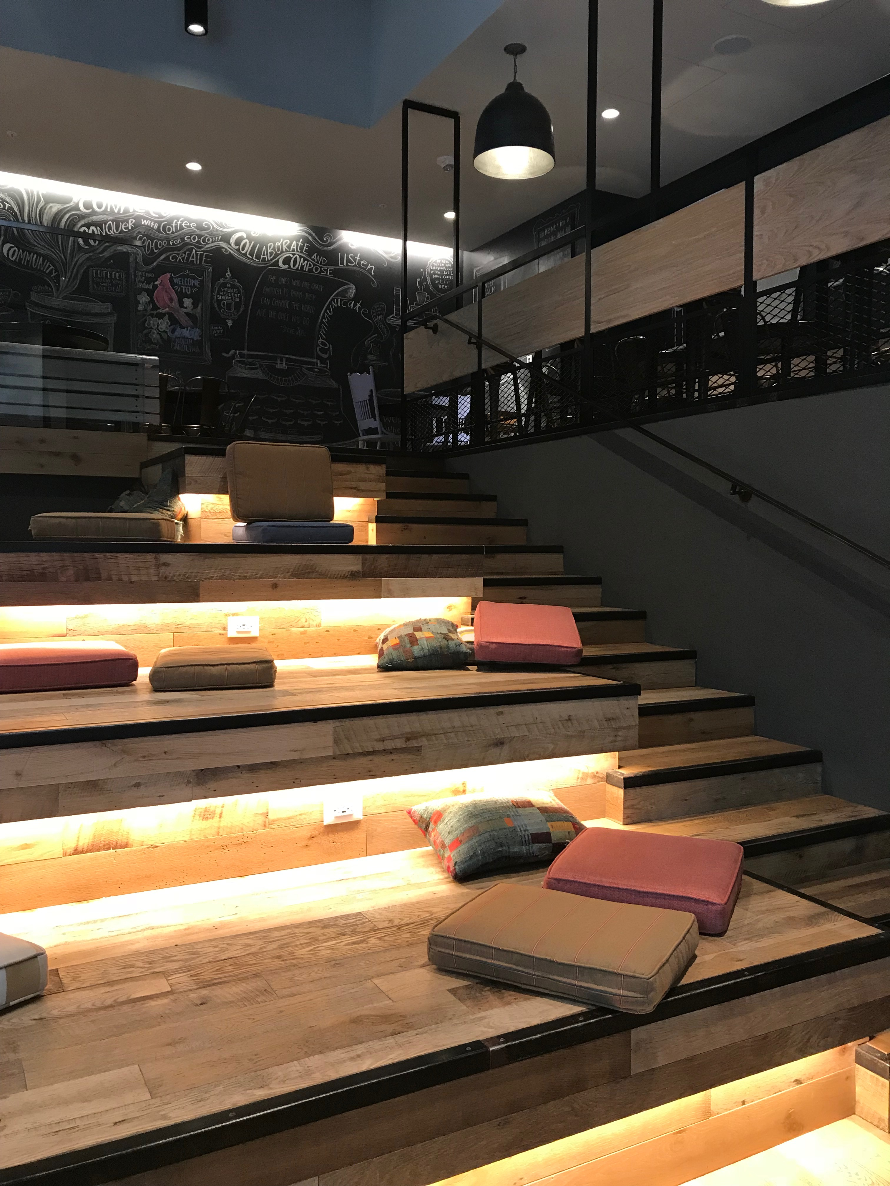 staircase with pillows for watching tv or reading at coffee cafe charlotte nc
