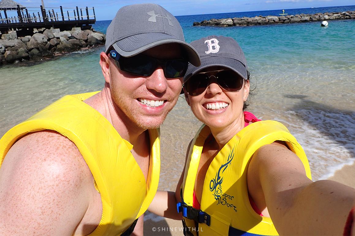 couple in yellow life jackets sandals grenada Caribbean resort