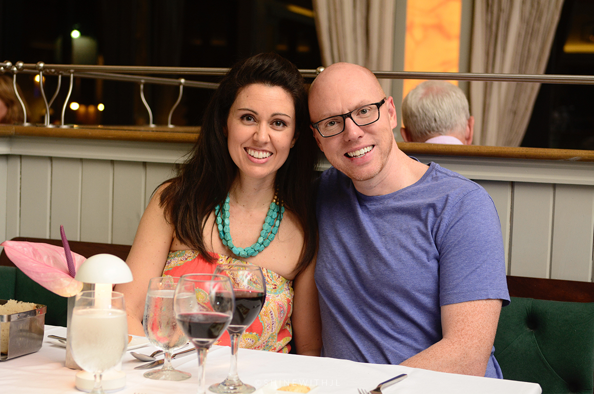 couple dining at sandals grenada with wine