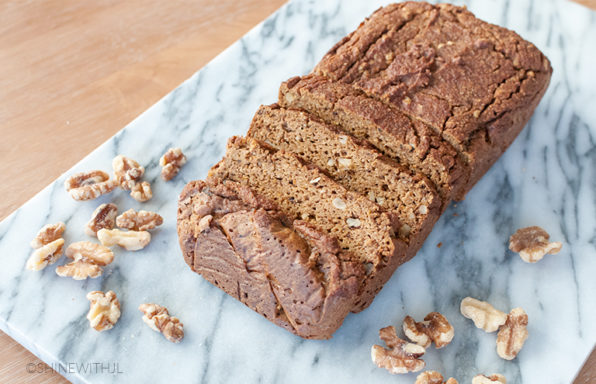 gluten free pumpkin bread loaf with walnuts on serving tray