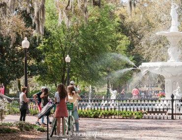 trumpet player girls on bike forsyth park fountain
