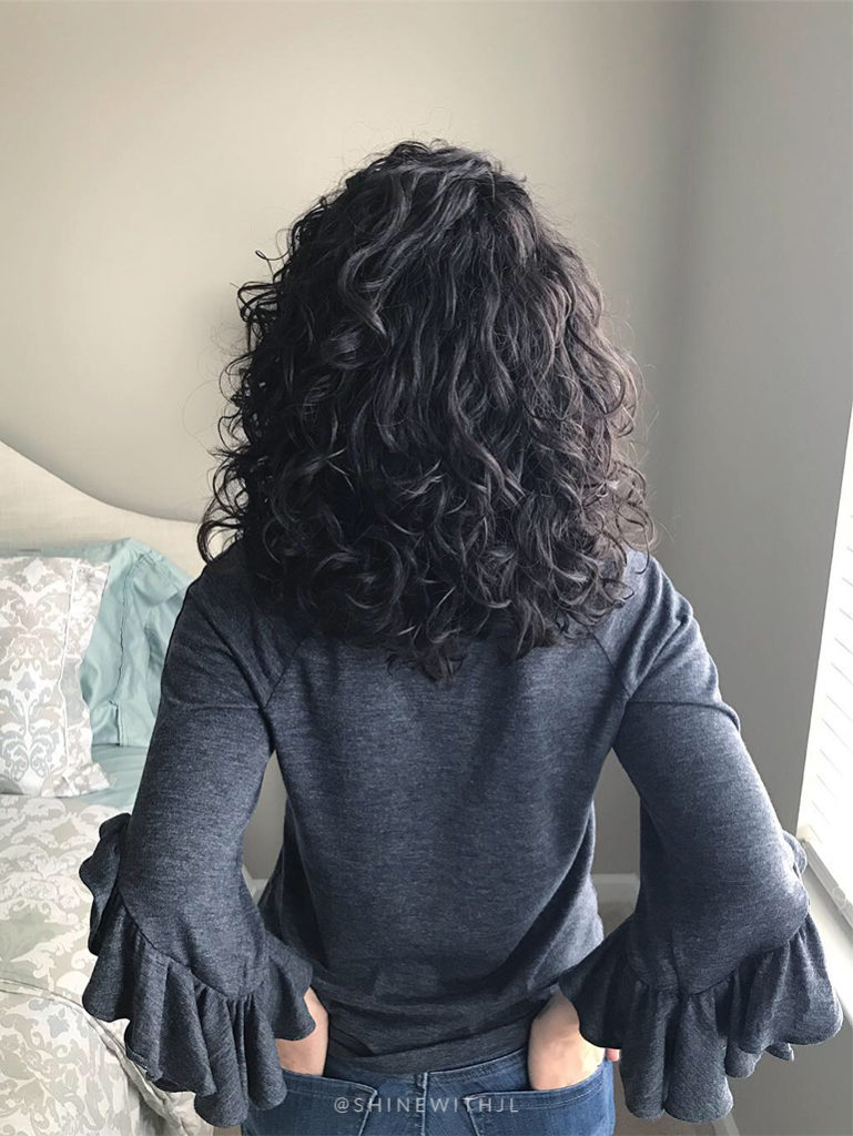 back of head curly hair ruffle sleeve shirt grey