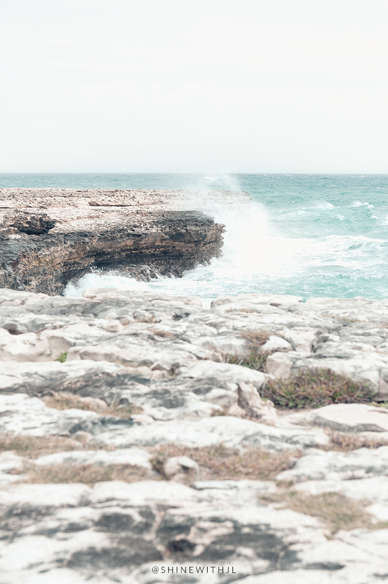waves crashing against rocks devils bridge antigua