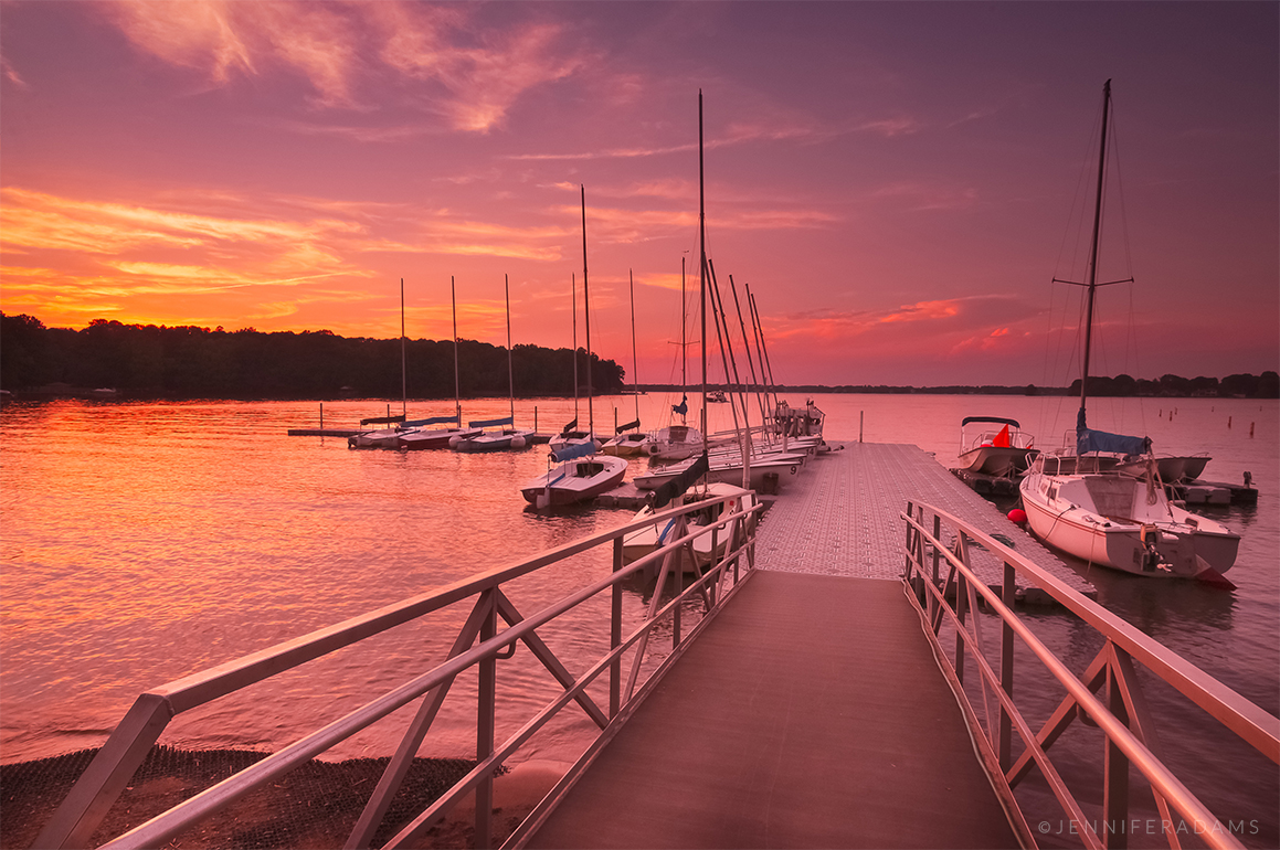 boats docked at sunset on lake norman in huntersville nc
