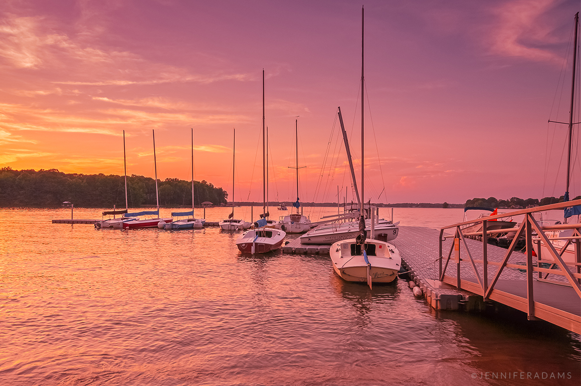 sailboats docked at sunset on lake norman at blythe landing park in huntersville north carolina