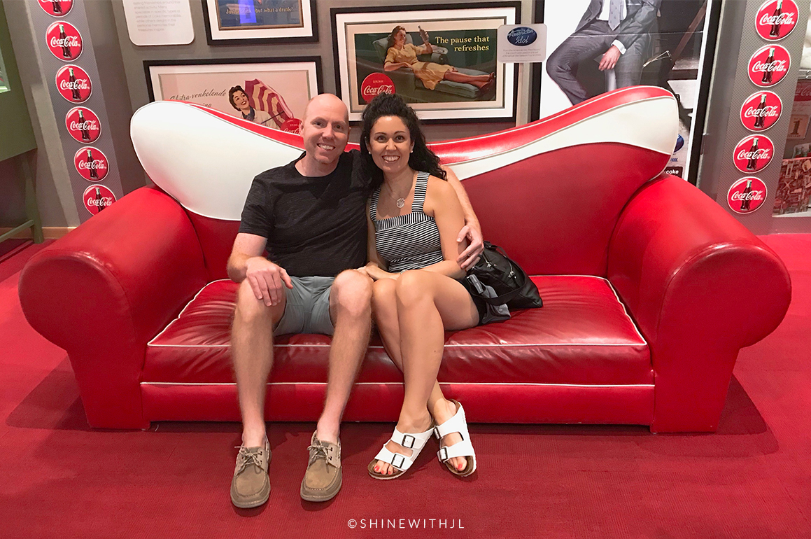 couple on red sofa world of coca-cola museum atlanta