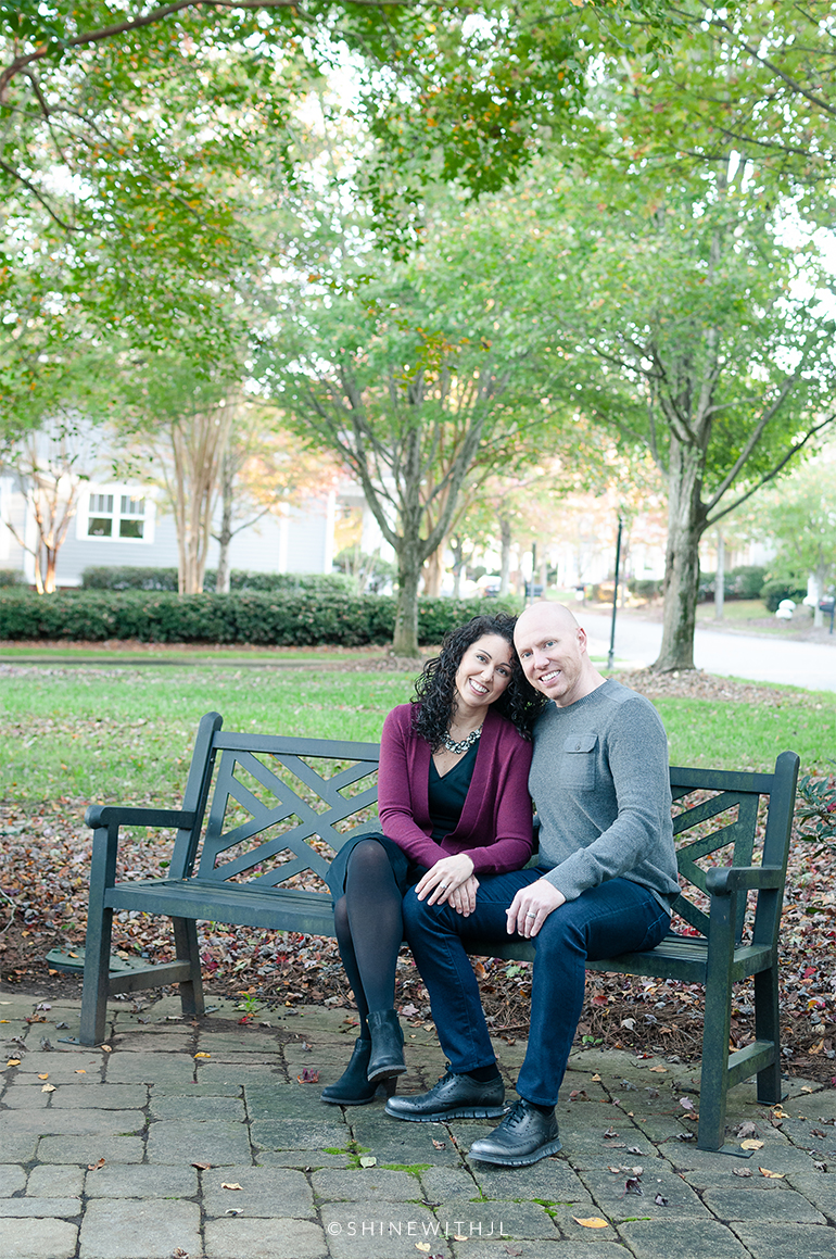 curly hair couples portraits park bench