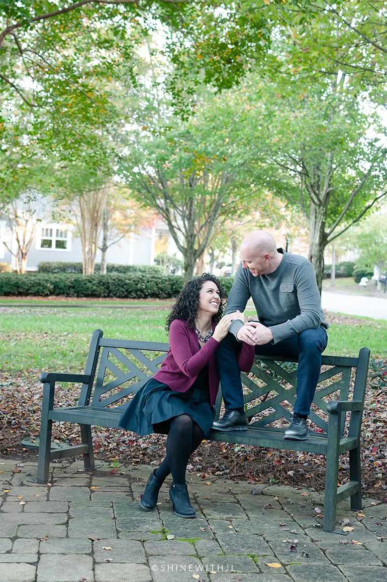 couples portrait pose park bench