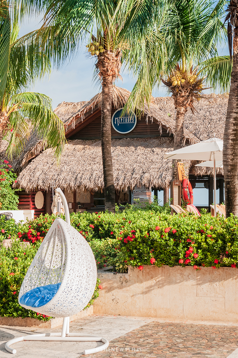 hanging wicker chair by neptune's restaurant sandals grenada resort