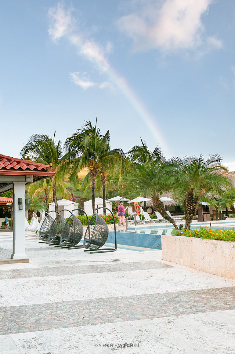 rainbow over the pool at sandals grenada resort luxury included