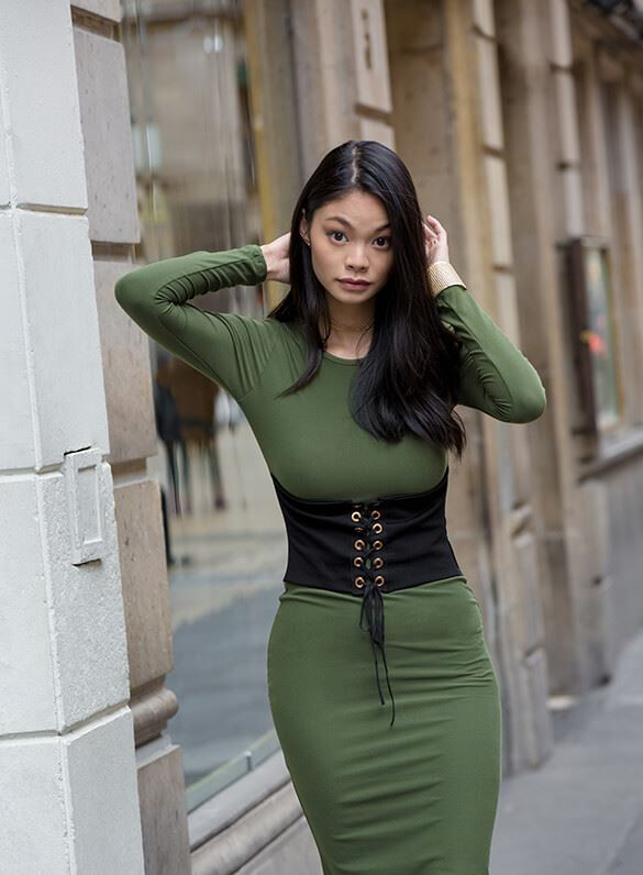 Go for the drama in a rich olive midi dress with an all-eyes-on-you corset.