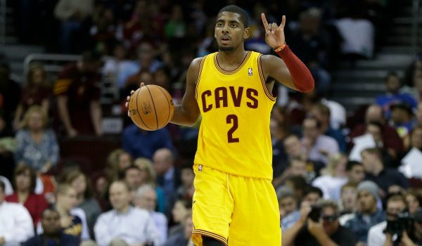 Cleveland Cavaliers' Kyrie Irving signals a play during an NBA basketball game against the Chicago Bulls Friday, Nov. 2, 2012, in Cleveland. (AP Photo/Mark Duncan)
