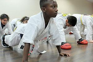Kids Kung Fu, kids pushups, black child, workout, pushups, kids kung fu, kids kung fu classes, lakeland martial arts, lakeland day camps