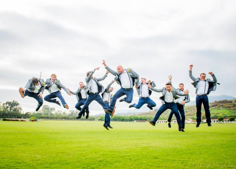 springtime rustic groomsmen kick