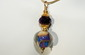 The Edge of Forever: Lampwork beaded Necklace Swirls of Purple and Blue with Gold Filled Wire