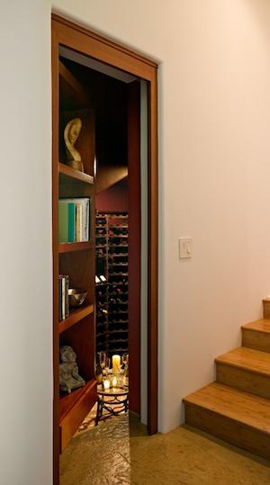 Bookcase to hidden wine cellar