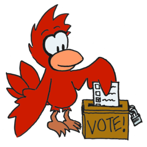 "A cardinal casts his paper ballot in an old-fashioned wooden voting box with a slot in the top and a padlock keeping it closed. The box reads ""VOTE!""."