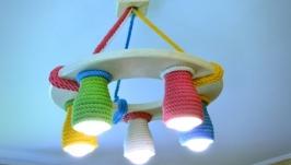 Деревянная люстра для детской комнаты с цветными плафонами