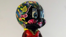 Пупс Веселый Эфиоп статуэтка.