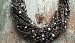 Эко-колье из темных натуральных льняных нитей и бусин цвета металлик.