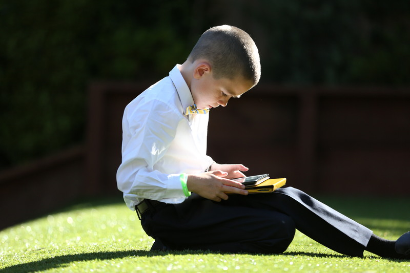 kid playing with tablet in the sunshine