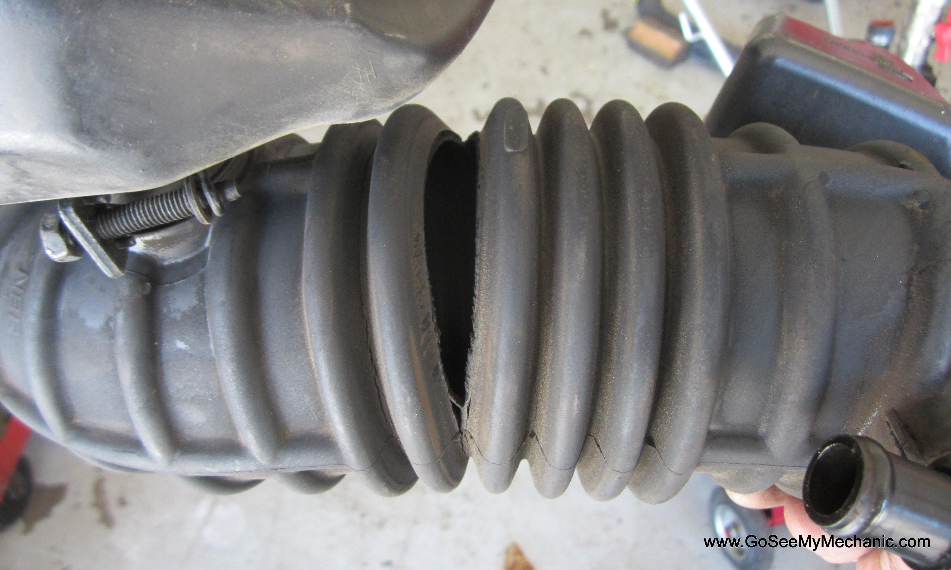 Torn air induction boot creates false air lean code P0171