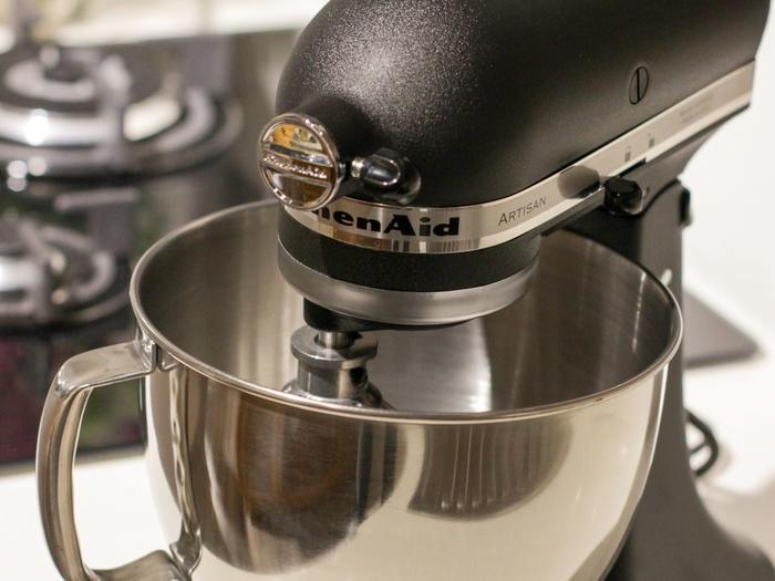 Black and silver kitchenaid stand mixer on top of white 1450907