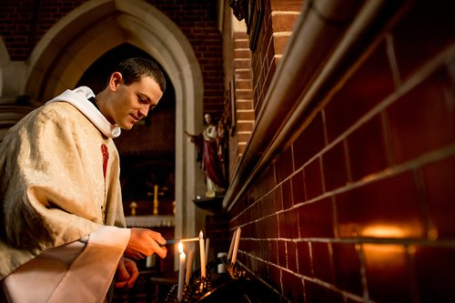 Clergy lighting candles