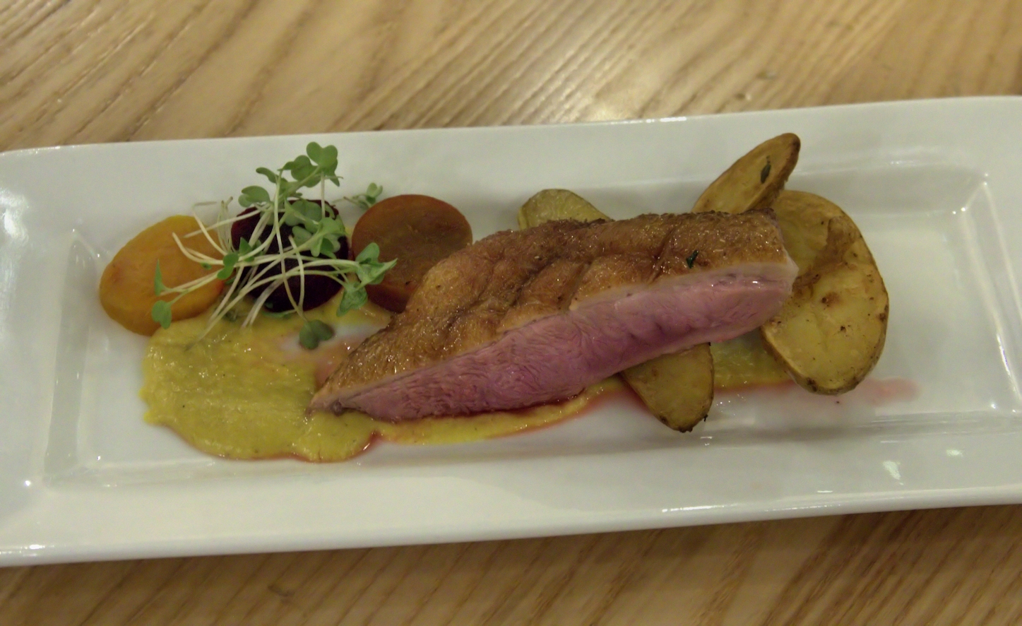 Duck breast with curried corn puree smoked beets and roasted fingerling potatoes