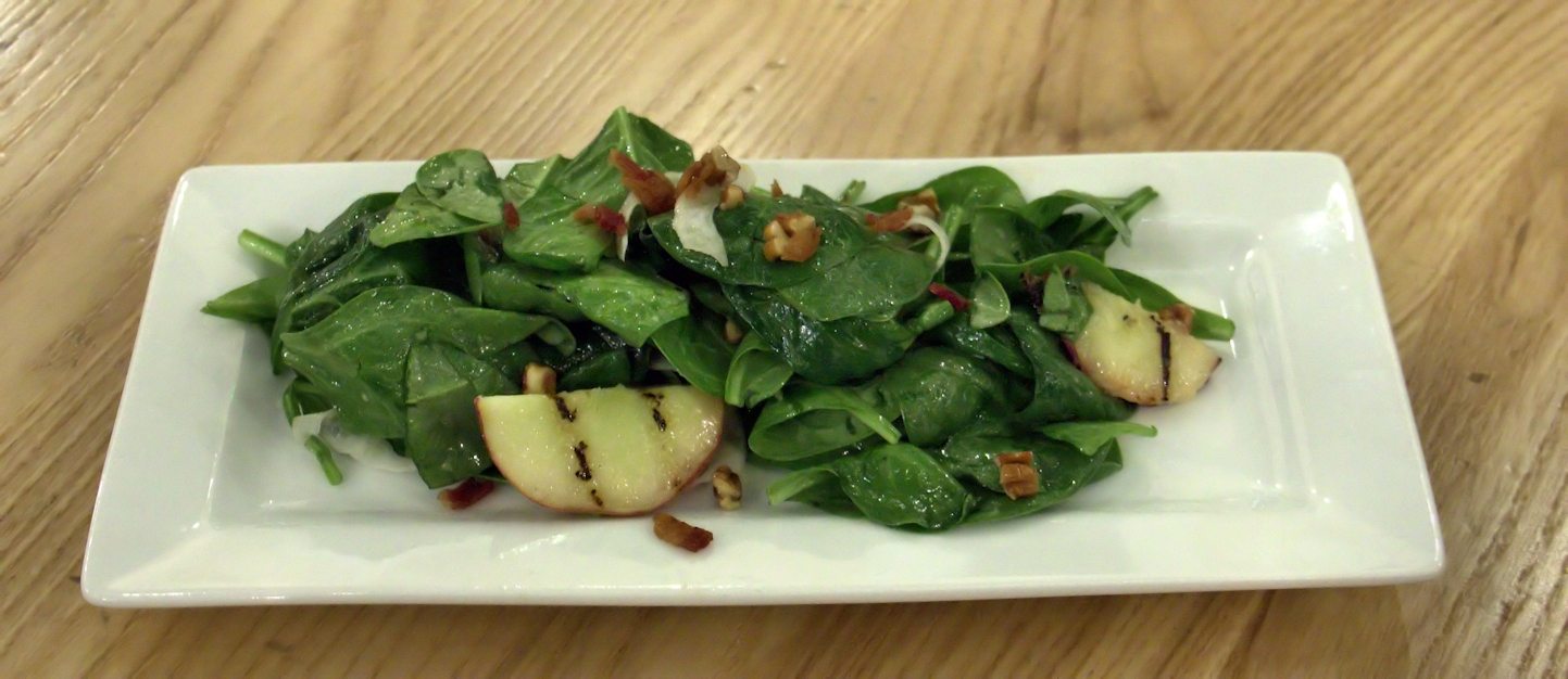 Spinach salad with walnuts, grilled pears and warm bacon dressing