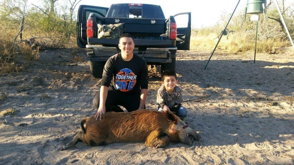 Gavin with his 1st Hog Harvest... Congrats buddy!