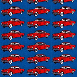 Red 1954 Studebaker 2 door on navy background
