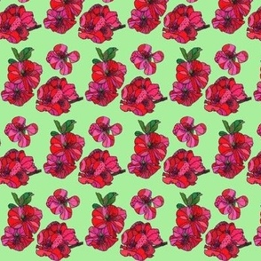 mini red cherry blossoms in green
