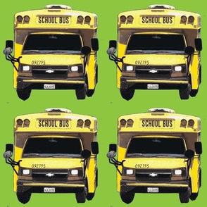 little yellow school bus on green