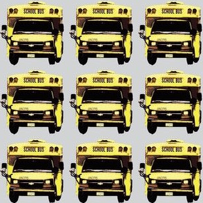 little yellow school bus on gray