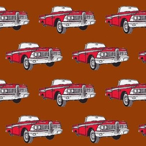 Red 1959 Edsel Corsair convertible on brown background