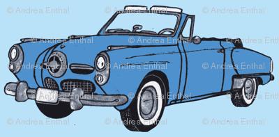 medium blue 1950 Studebaker convertible bullit nose on light blue
