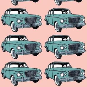 green 1959 Studebaker Lark on pink background
