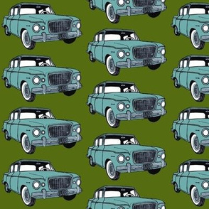 light green 1959 Studebaker Lark on forest green background