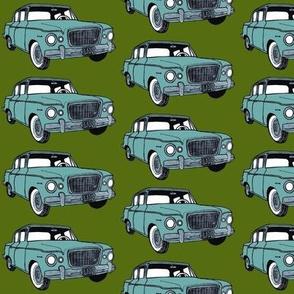 light green 1959 Studebaker Lark on forest green background