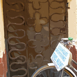 Bike in front of Wrought Iron Grill in Front of Door, Collioure, France