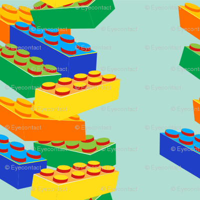 Kids' toy building blocks stacked in blue-green background