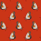 Lovely butterfly design on red smaller.