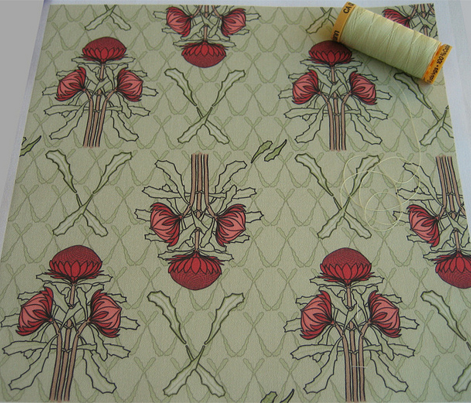 Waratahs and crossed leaves on green